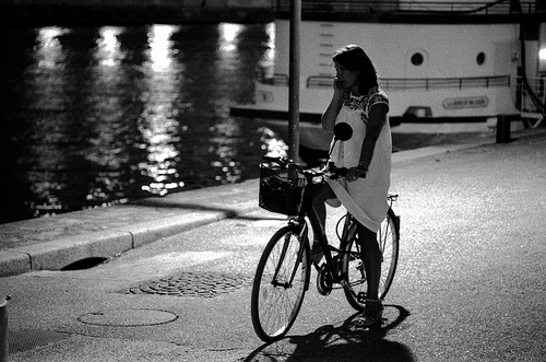 Girl with bicycle near the Seine