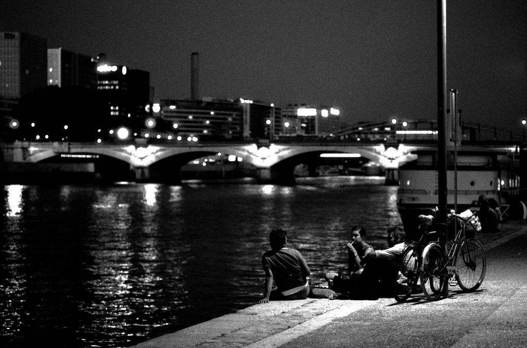Sitting near the Seine at night